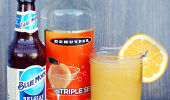 Blue Moon beer, Triple Sec and orange juice in a mason jar with an orange slice
