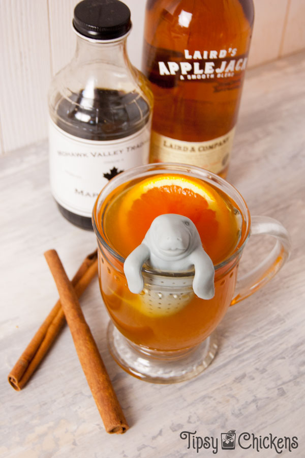 Sit back and sip a fall ready hot toddy made with applejack, orange and hot chai perfect for a cool autumn day in the hammock or by the last bonfire of the season #autumncocktail #fallcocktail #applejack #applejackcocktail #hottoddy #applejackhottoddy