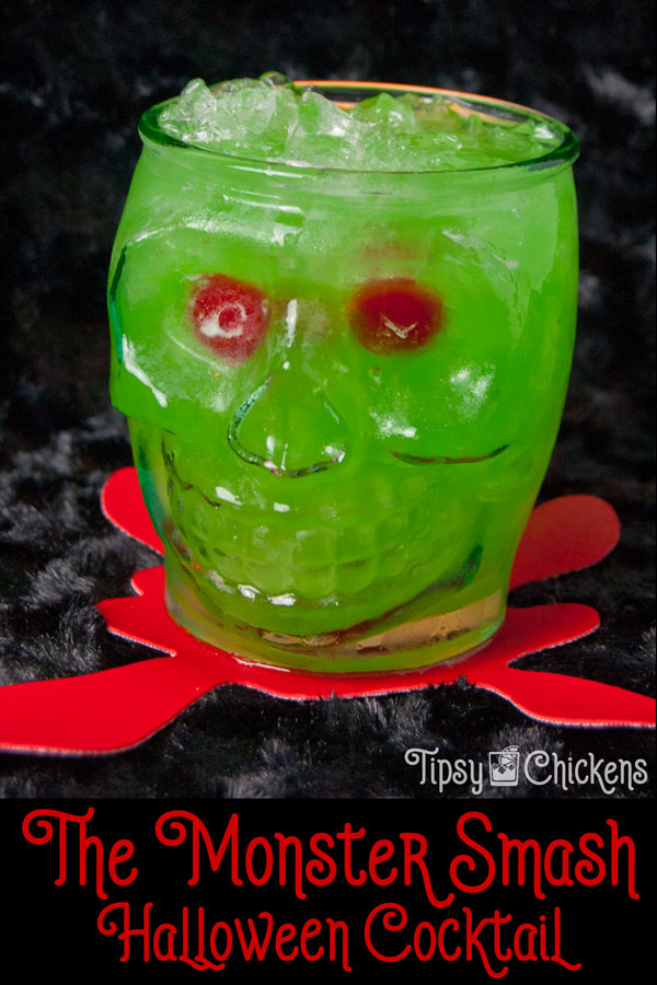 With a Monster Smash in your hand you'll be the life of the party at your next Monster Bash while you Monster Mash. This tropical tasting Halloween Cocktail gets it's flavor and color from Pineapple Juice, Midori and Blue Curacao #Halloween #Halloweencocktail #adulthalloween #midori #rumcocktail