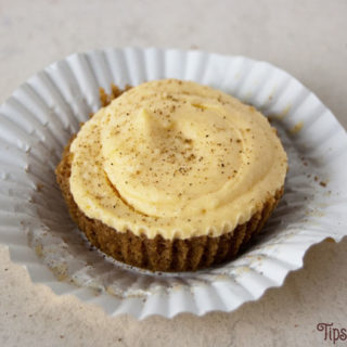 mini eggnog cheesecake made with speculoos cookie crumb crust, vanilla pudding, eggnog and brandy sprinkled with nutmeg