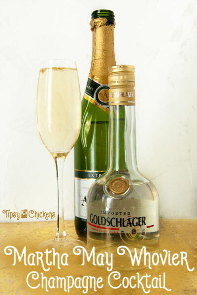 champagne flute filled with dry champagne, triple sec, goldschlager and edible gold leaf with a bottle of champagne and a bottle of goldschlage on a gold surface with a white background