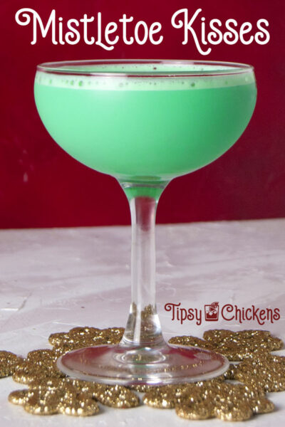 mint and Irish cream Christmas cocktail in a coupe glass on a golden snowflake