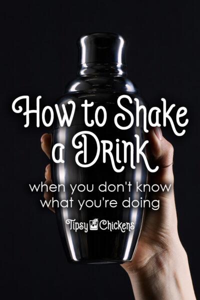 cocktail shaker against black background