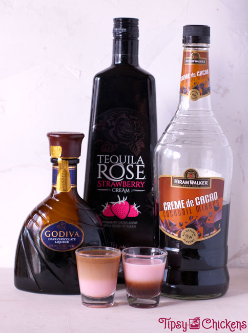 chocolate liqueurs layered with tequila rose in two shot glasses to show how different densities layer