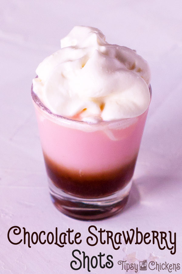 shot glass filled with tequila rose and chocolate liqueur topped with whipped cream